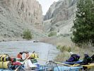 A rafting group stopped on the shore of the Bruneau River