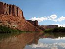 The red cliffs beside the Green River reflecting in the water
