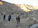 Three women hiking up a slope in Gray Canyon, Green River, Utah