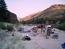 A river rafting party camped on a beach