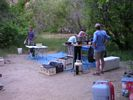 People setting up a river kitchen on top of a floor tarp