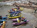 A row of colorful catarafts parked at Lake Creek, Middle Fork Salmon, Idaho