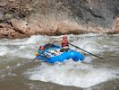 A raft in the whitewater of Crystal Rapid, Grand Canyon
